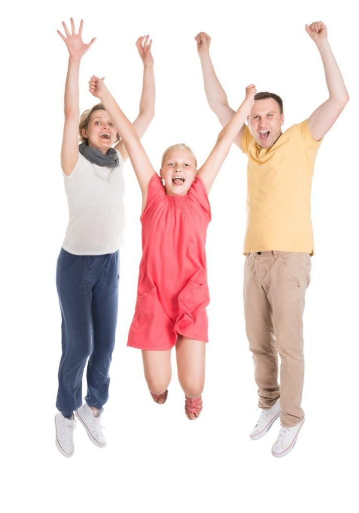 Excited Young Happy Family Jumping. Isolated On White